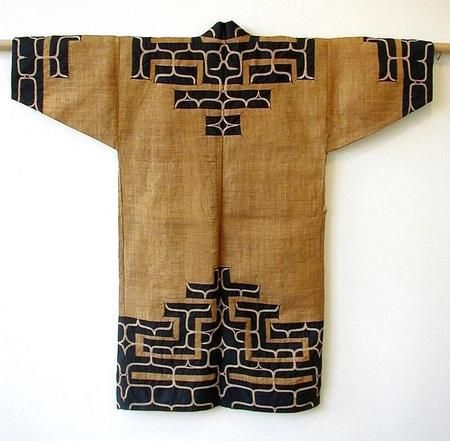 Japanese Ainu Robe, Woven Elm Bark     Japanese traditional tribal robe worn by the Ainu people of Northern Japan, woven out of fine strips of elm bark with wide strips of dark indigo cotton cloth and chain stitch embroidery, minor wear, circa 1920's. Length: 50 inches. $  10,000  I love the pattern - and the black and white against the warm brown.