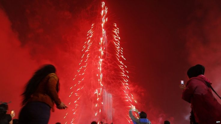 "People watch as Dubai celebrates the new year with a light and sound extravaganza at midnight at the Burj Khalifa, the world""s tallest tower (four hours ahead of Greenwich)"