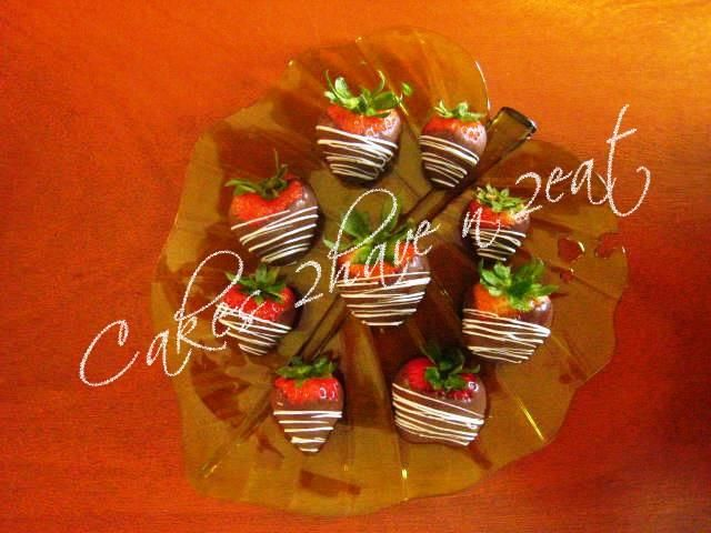 Chocolate dipped strawberries and drizzled with white chocolate, divine!