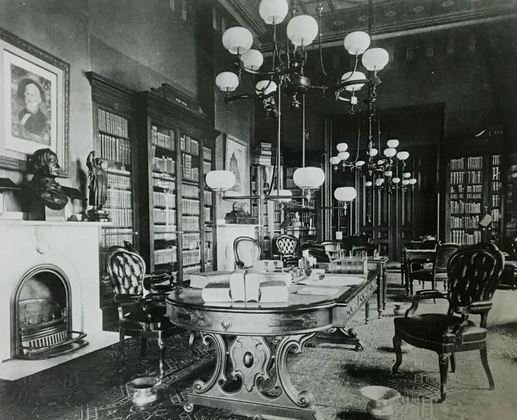 This photograph was taken in 1887 by the photographic studio of Gilbert and Bacon. They were hired by the Union League to create a photographic album documenting the building after it was decorated by League member George Herzog. This was the Library, which is today the Fell Room. Notice the chewing tobacco bowls which sit on the floor close by each chair. It is also worth noting the beautiful frescoes ceilings and white mantle fireplace. #History #HistoryLovers #Architecture