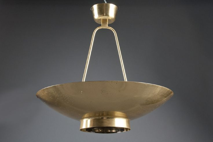 Paavo Tynell (1890-1973)  Taito Oy Edition, Finland, 1975  Brass perforated dish, mounted with a frosted glass diffuser over a concentric ring shade, suspended from a forked stem and original canopy. Designed in 1952, executed in 1975.