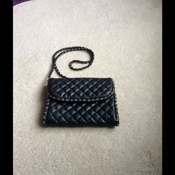 Mango bag Quilted panel bag from Mango.Black leather and gold hardware.its a small bag. Mango Bags Mini Bags