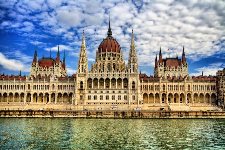 Art: The picture shown is the Parliament of Budapest. Its height is 315′.  Parliament of Budapest is a notable landmark of Hungary and a popular tourist destination of Budapest. Buda and pest was made together to make Budapest in 1873. The  Parliament Building was opened in 1904 and was for expressing the sovereignty of the nation. About 100,000 people were involved in construction for building the Parliament