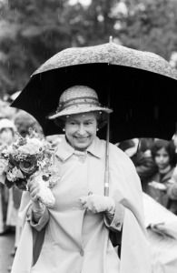 Queen Elizabeth II smiling despite the rain as she went walkabout at HMS Warrior in Northwood,…