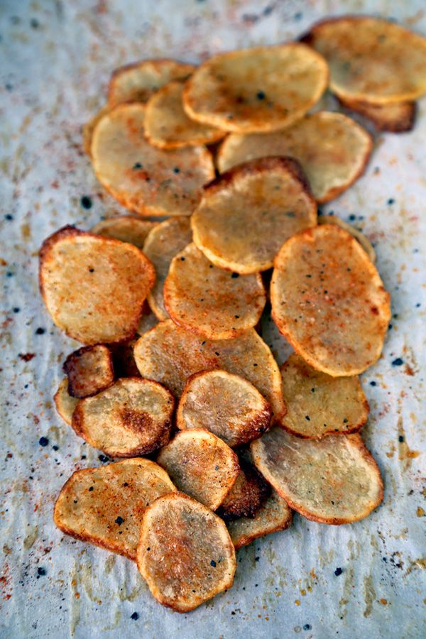 Healthy snack: Oven baked potato chips with paprika and salt