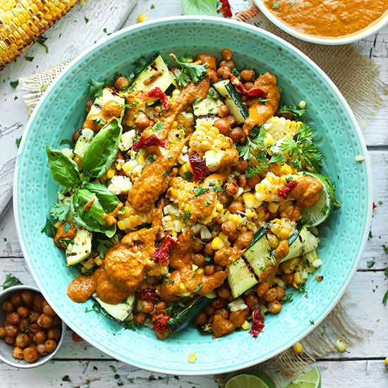 An amazing, light summer dish: 30-minute Grilled Zucchini & Corn Salad with sun-dried tomato vinaigrette! Top with roasted chickpeas for even more protein.