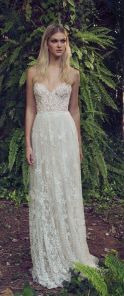 Beautiful boho chic spaghetti strap floral and leaf embroidered sheath wedding dress; Featured Dress: Limor Rosen