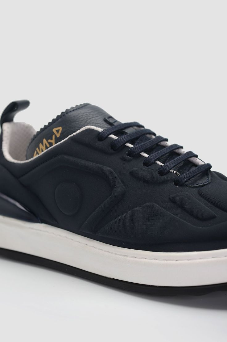EAT MY DUST Al Blue Sneakers. Navy blue sneakers with textured pattern throughout.
