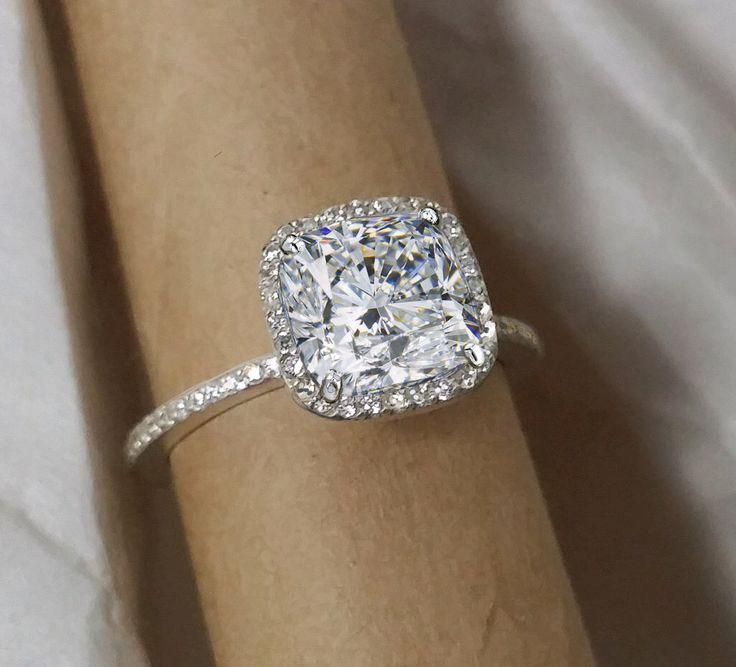 Cushion cut Diamond halo engagement ring. Charles Colvard Forever Brilliant moissanite. by MichaelPatrickHogan on Etsy https://www.etsy.com/listing/204346968/cushion-cut-diamond-halo-engagement-ring