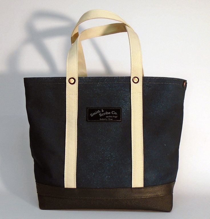 Cotton canvas tote bag - navy blue with natural colored webbing strap  ● 100 % cotton canvas 800 gr/m² (28 oz), navy blue, hand dyed - imbibition cooked dyeing ● 3 mm webbing strap - 100 % cotton, double ● strengthened by 3 cm painted webbing - dark gray, 100 % cotton, applied by hand ● painted side and bottom - dark grey, applied by hand ● screen printed leather brand tag ● heavy duty copper rivets, hand hammered ● high quality polished gold metal zipper  Size: 14 cm x 36 cm x 46 cm