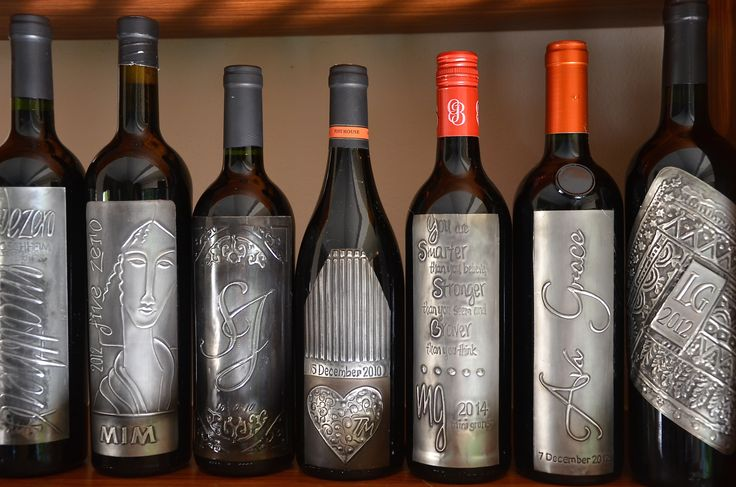 pewter wine labels made for our various family celebrations. Mary Ann Lingenfelder. Mimmic Gallery and Studio.
