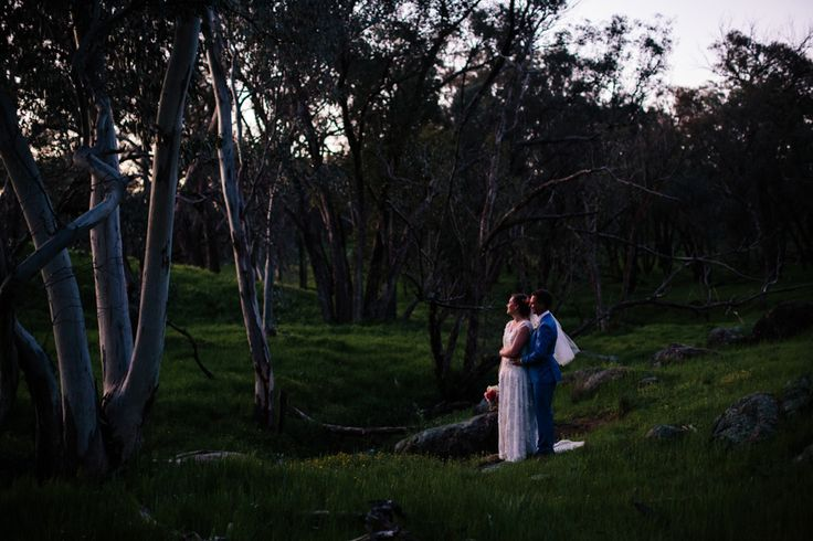 Bride and groom at dusk / sunset next to a creek in a forest in country new South Wales