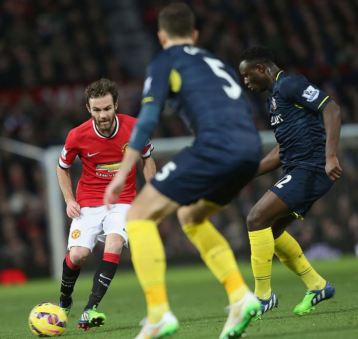 Juan Mata of Manchester United in action with Victor Wanyama of Southampton during the Barclays Premier League match between Manchester United and Southampton at Old Trafford