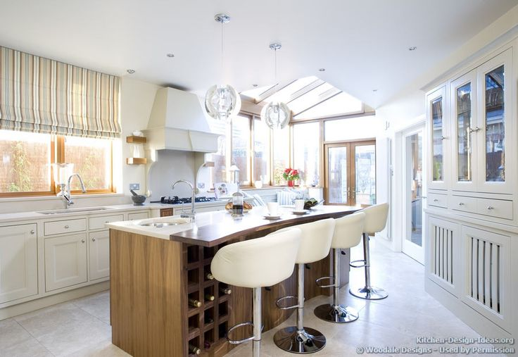 Beautiful Skylights, a Curved Island, and an Elegant Wood Hood  (WoodaleDesigns.ie, Kitchen-Design-Ideas.org)