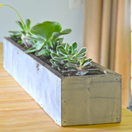 I wanted to recreate an actual zinc planter and I achieved the look by making a simple wood box, then covering it with aluminum flashing.