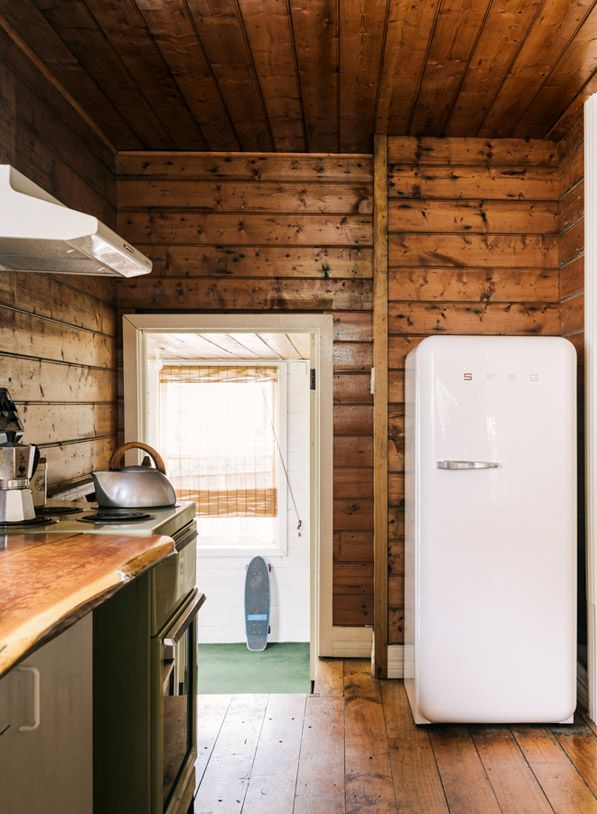 I love the white around the door frames to break up all the wood. We need to do this @ project myola! We also need the smeg @ project myola!!
