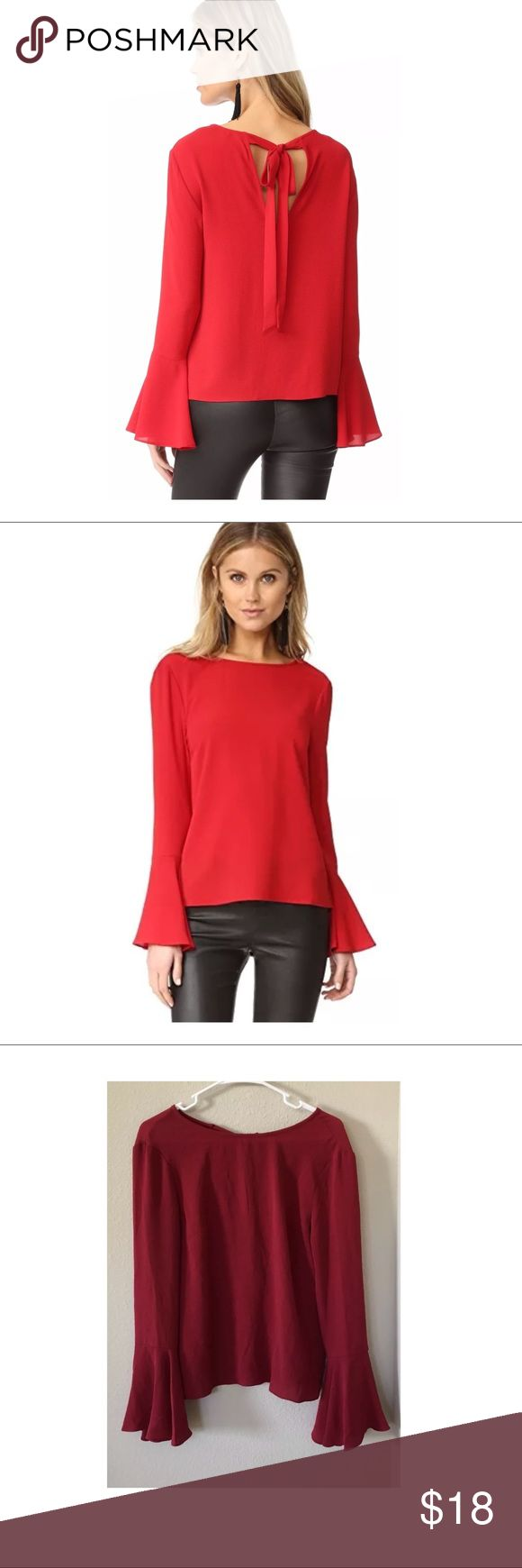 """$59 NEW WAYF for Nordstrom 'Winning Hand' Blouse $59 NEW WAYF for Nordstrom 'Winning Hand' Bell Sleeve Blouse Red ~XS~  New without tags. Retails for $59 + Tax. Model to show fit   Red Soft, lightweight Adjustable tie behind back Open back   Size XS  Measures approximately: total length 24"""" bust across 18""""  High end department store shelf pull- new without tags. May have had customer contact Designer tag is loose from one of the seams- shown in photos.   PLEASE ASK ANY QUESTIONS BEFORE…"""
