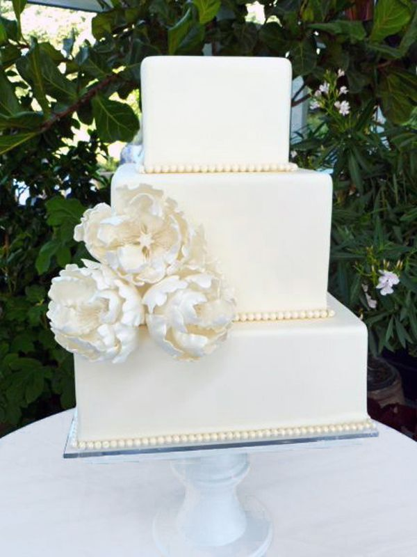 Tall, white, and simple cakes like this one are a perfect addition to any elegant wedding.