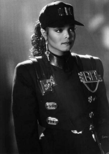 "Janet Jackson, ""Rhythm Nation"" ..this era of Janet Jackson was amazing... I love the military chic... The message... And I still rock a key on my earring when I at the gym lol"