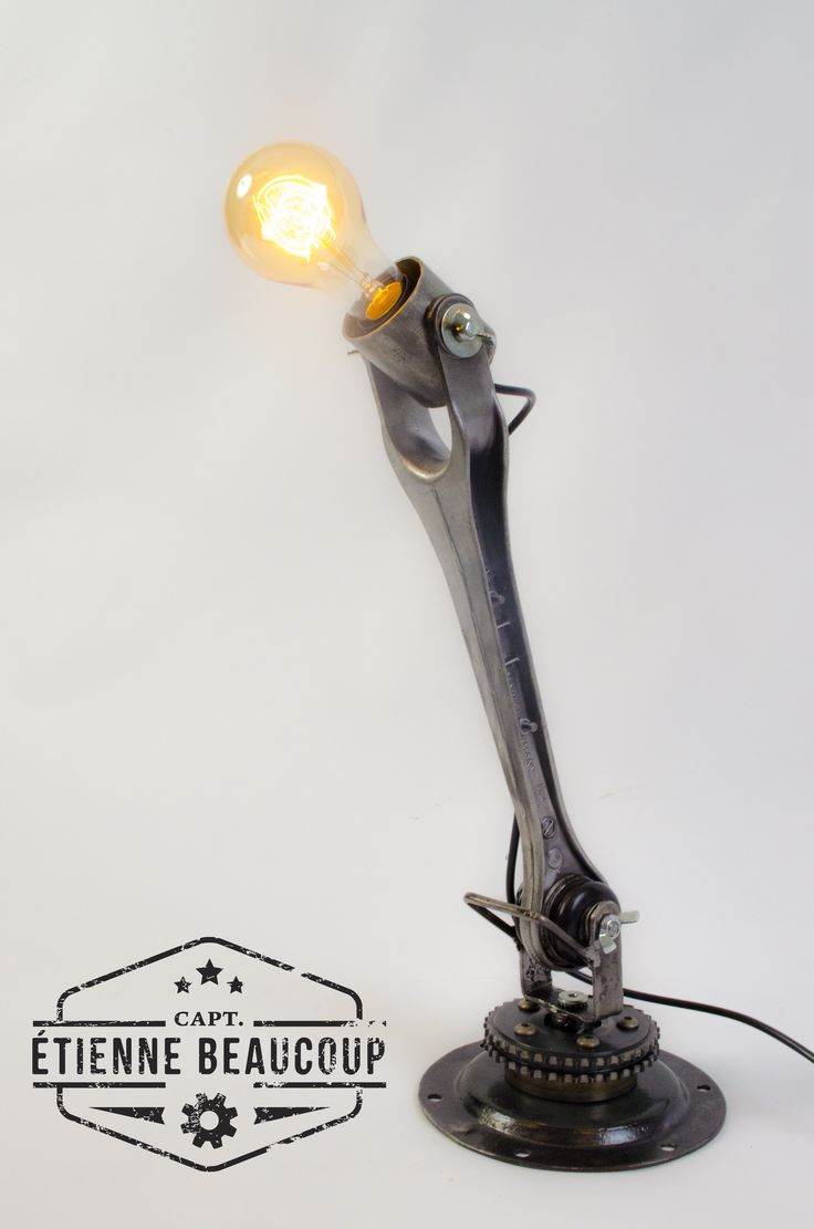 This custom ordered upcycled desklamp is created from a part of the hanging of a Porsche 911 and other old carparts and scrapmetal. The different parts can move so you can adjust the lamp to your needs.  Special thx to the Porche Center Brussels to let me dive into there scrapcontainer .