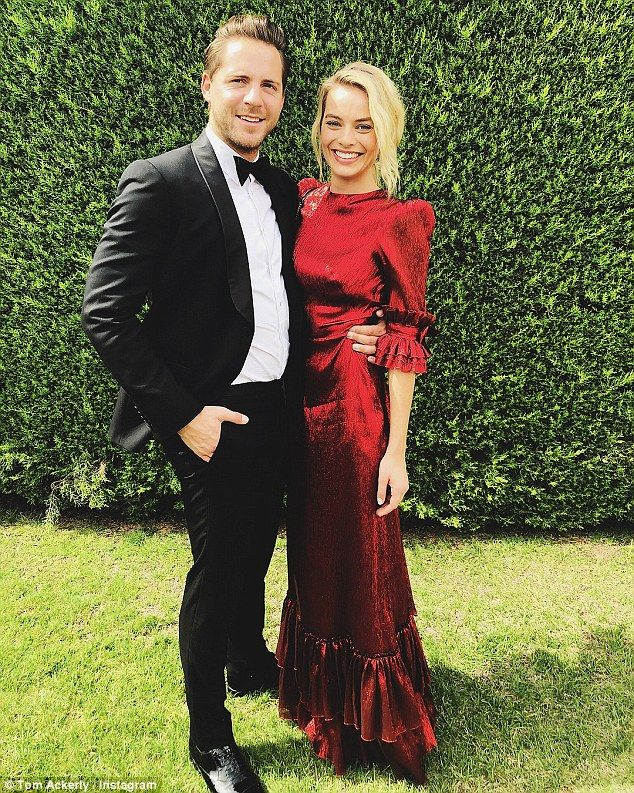 Nuptials: Margot Robbie (right) managed to avoid the crowds when she flew to Australia ove...