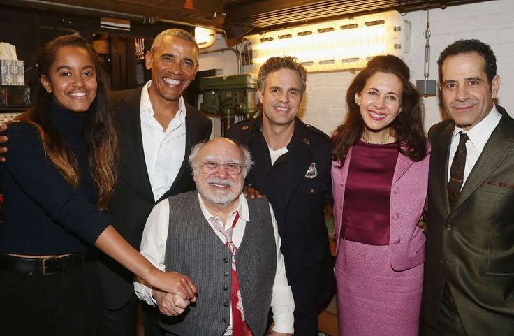 """The Obama family: Life after the White House Posing with his daughter Malia (L) and actors Danny DeVito (3rd L), Mark Ruffalo (C), Jessica Hecht and Tony Shalhoub (R) backstage at the Roundabout Theatre Company's production of Arthur Miller's """"The Price"""" on Broadway on Feb. 24, 2017 in New York City. Celebrities Visit Broadway - February 24, 2017 - Bruce Glikas/FilmMagic/Getty Images"""