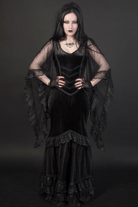 Calliope gothic dress by Sinister is made from black velvet with long flowing mesh sleeves trimmed with black lace.