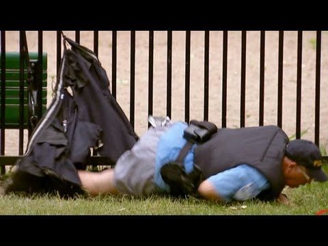 Cop Loses His Pants Climbing Over Fence!