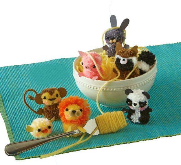 Use a fork to make a family of fuzzy pompom critters. | 34 Of The Cutest DIY Projects You've Ever Seen