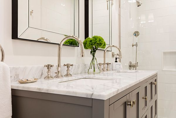 We can't take our eyes away from this gleaming double vanity with a marble countertop and polished nickel fixtures.