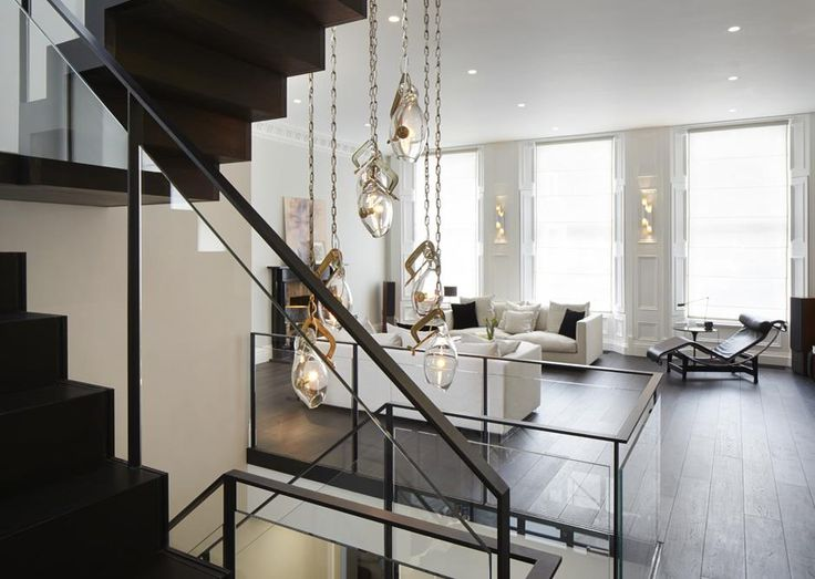 Emperor's Gate | South Kensington Our Custom designed staircase punctures through three apartments to combine them into one singular luxury Kensington Mansion.