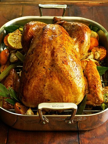 Southern-Style Thanksgiving Dinner -Simple Roast Turkey ..This is pretty much how I make mine, however I omit the thyme and spinkle smoked paprika over the bird before cooking. Adds beautiful color.