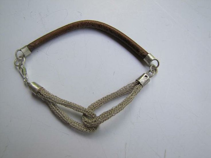 Silver and leather bracelet is made by Berrin Duma. SOLD