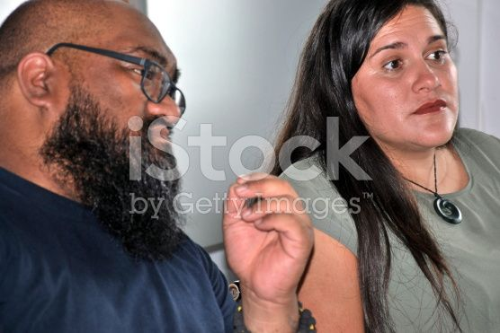 Maori and Pacific Island Couple in Meeting Situation royalty-free stock photo
