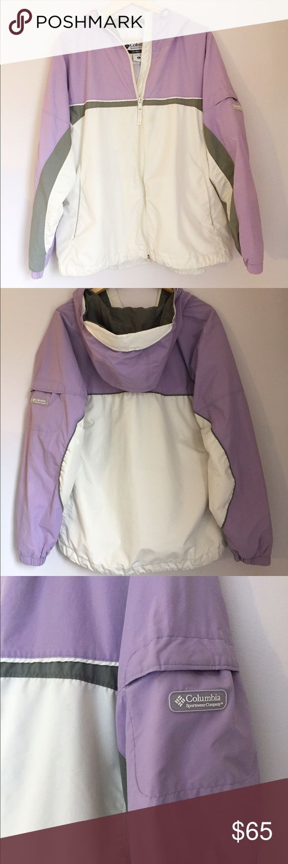 """Columbia Lightweight Hooded Jacket Purple White •Columbia Lightweight Hooded Jacket / al season jacket •In excellent condition •Light purple, white, and gray in color •Two pockets at hip; one pocket on arm with Columbia Sportswear Company logo, one inner mesh pocket •Hooded and lined •Hood and waistband have elastic drawstring; cuffs are elastic •Material content can be found in photo of tag •Al measurements are approximate: length 28""""/ armpit to armpit 23""""/ armpit to end of sleeve 22"""" •I'm…"""