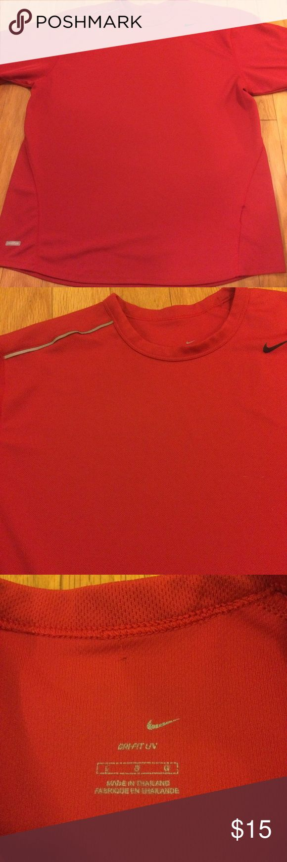 Nike drifit uv shirt Nike drifit red shirt with reflectors on both sides of the shirt. Worn twice but needed a different size. Nike Shirts Tees - Short Sleeve