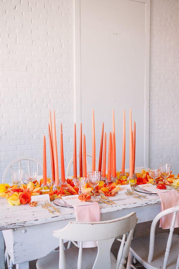 tall taper candle centerpiece, styling by Sarah Park Events, photo by Sweet Root Village http://ruffledblog.com/orange-crush-wedding-ideas #orange #weddingideas #centerpieces