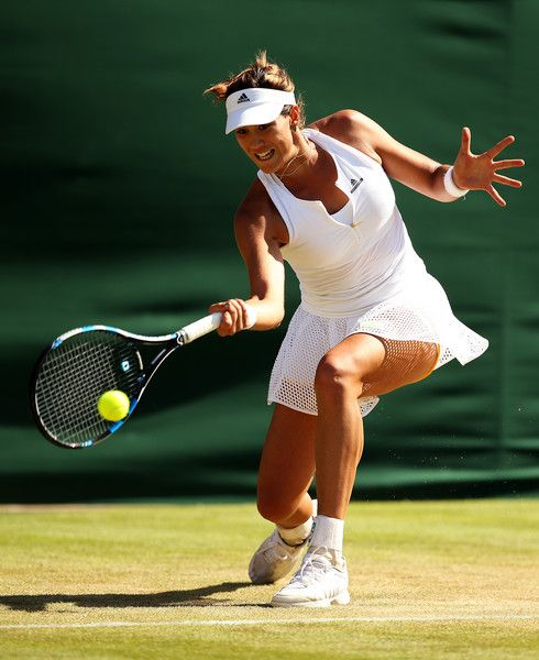 Garbine Muguruza Photos - Garbine Muguruza of Spain plays a forehand in her Ladies' Singles Fourth Round match against Caroline Wozniacki of Denmark during day seven of the Wimbledon Lawn Tennis Championships at the All England Lawn Tennis and Croquet Club on July 6, 2015 in London, England. - Day Seven: The Championships - Wimbledon 2015