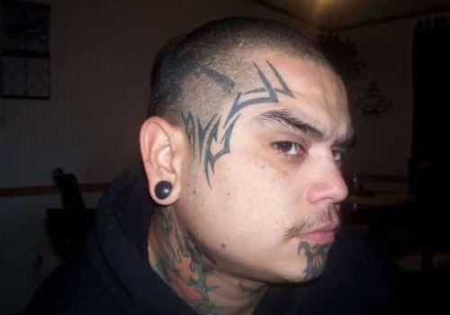tribal-face ~ http://heledis.com/beautiful-face-tattoo-designs/