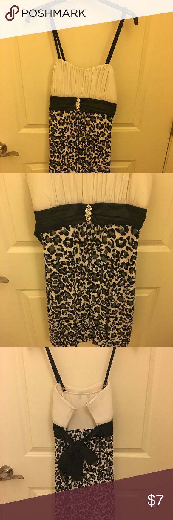 Black and white dress White bust area. Black and white animal print with crystal brooch in the center.  There is slight discoloration in one of the pictures that isn't noticeable and must be from sitting in the closet for 5-6 years. Awesome fun dress! Taboo Dresses