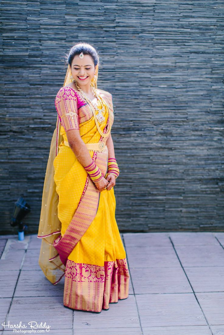 Traditional Southern Indian bride wearing bridal silk saree, jewellery and hairstyle. #IndianBridalMakeup #IndianBridalFashion. Temple jewelry. Jhumkis. Silk kanchipuram sari. Braid with fresh flowers. Tamil bride. Telugu bride. Kannada bride. Hindu bride. Malayalee bride