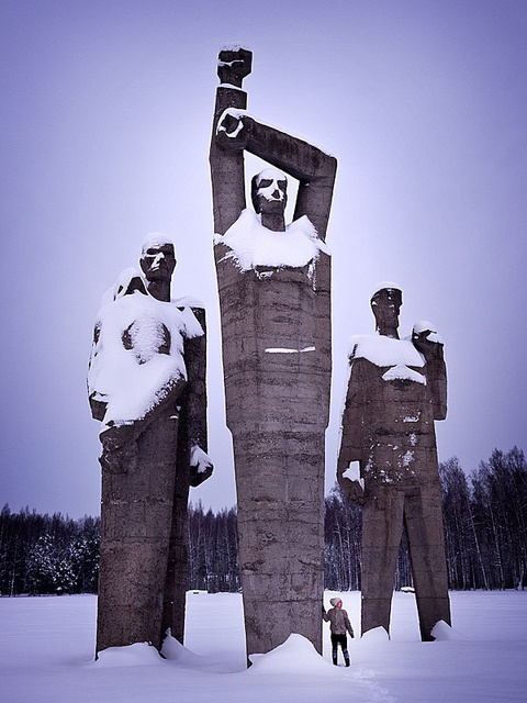 Snow-dusted statues inside the Salaspils memorial near Riga, Latvia.