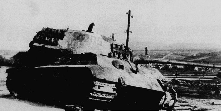 https://flic.kr/p/sg95Lw | A Tiger II destroyed by artillery.