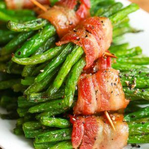 Bacon Green Bean Bundles. Tender green beans wrapped in bacon & brushed with a brown sugar glaze are easy enough for a weeknight meal or to serve to guests!