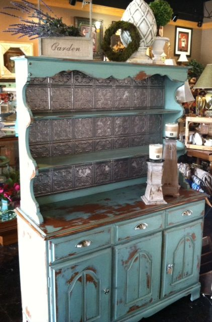In love with our newest project... Here is our two piece refurbished hutch painted in The Plaster Paint Company's Seaside Blue. Love the final touches of brushed nickel hardware and coordinating ceiling tile tins backsplash. ~ $450 https://www.facebook.com/MilkandHoneyCandleCo
