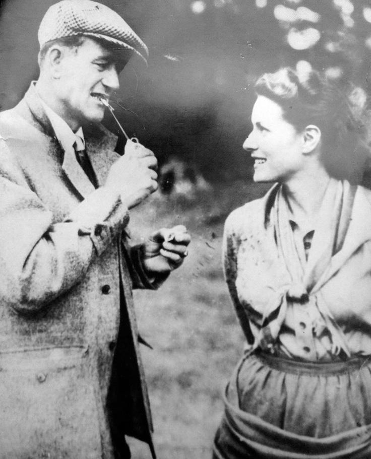 1951, Cong: John Wayne and Maureen O'Hara - between takes on the set of 'The Quiet Man'... —