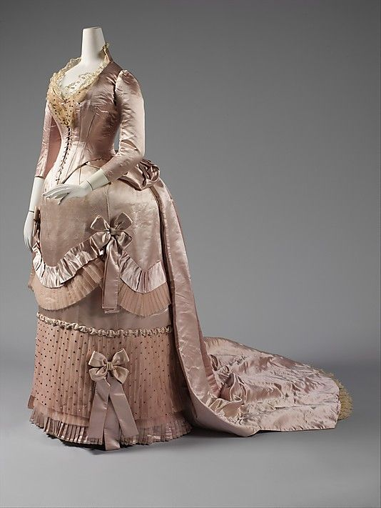 Court presentation ensemble House of Worth (French, 1858–1956) Designer: Charles Frederick Worth (French (born England), Bourne 1825–1895 Paris) Date: ca. 1888 Culture: French Medium: (a) silk, metal, feathers, glass; (b–d) silk, metal; (e, f) silk; (g) feathers, silk, metal; (h–l) silk, metal  Credit Line: Purchase, Friends of The Costume Institute Gifts, 2007 Accession Number: 2007.385a–l