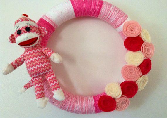 Pink Sock Monkey Felt Flower Wreath; Sock Monkey Decor; Girl's Sock Monkey Wreath; Felt Flower Wreath on Etsy, $40.00  Perfect sock monkey decor for a girl's room.  A great baby shower gift.