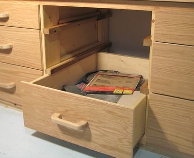 Guide to wooden drawer rails.  Metal hardware is not only expensive, it's unnecessary.  The less I spend, the happier I am (as long as I get close the the same results).