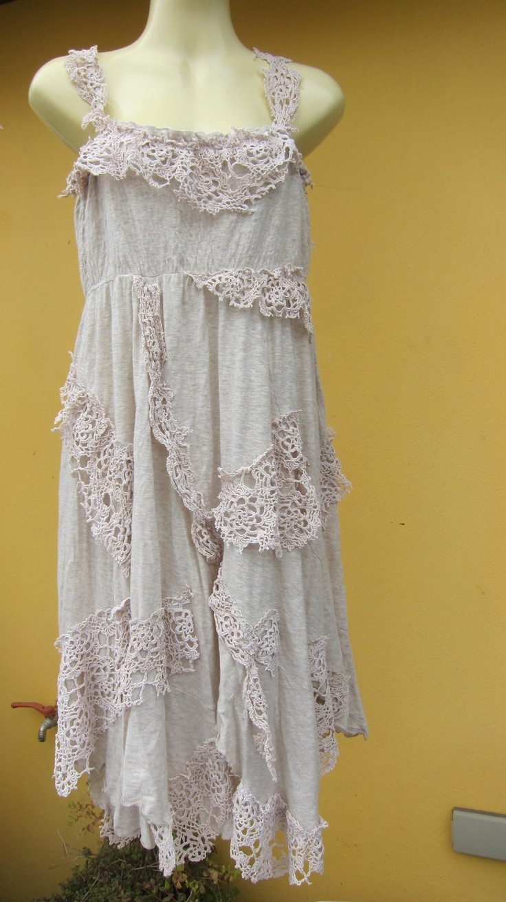 shabby chic...ivory cotton pixie hem dress with shabby pieces of crochet and doilies.... $55.00, via Etsy.